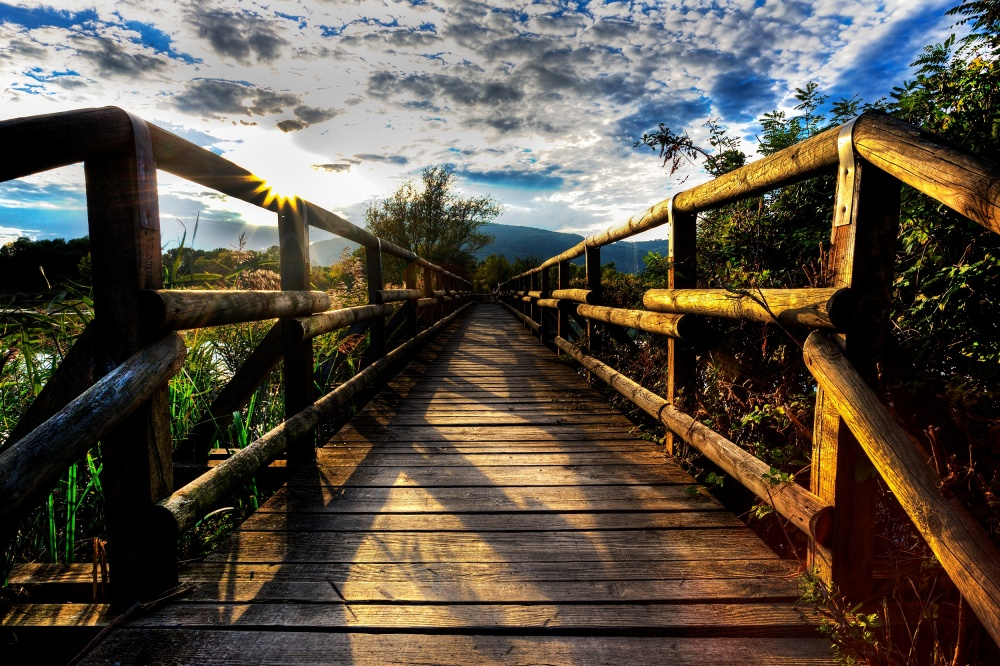 A piece of fine art art photography titled Walkway Over the Lake Iseo In Italy by Adolfo Mazzetti