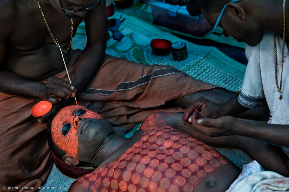 View this piece of fine art photography titled Painting a Theyyam Ceremony Performer- Kannur - India by Joxe Inazio Kuesta Garmendia