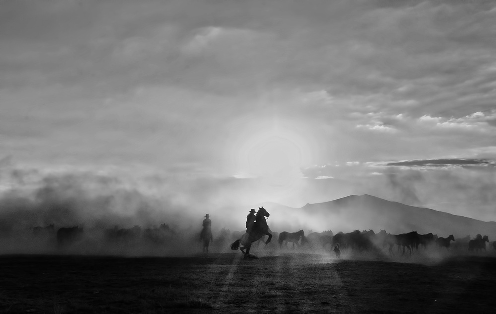 A piece of fine art art photography titled Wild Horse Collectors Cowboys by enginbasa