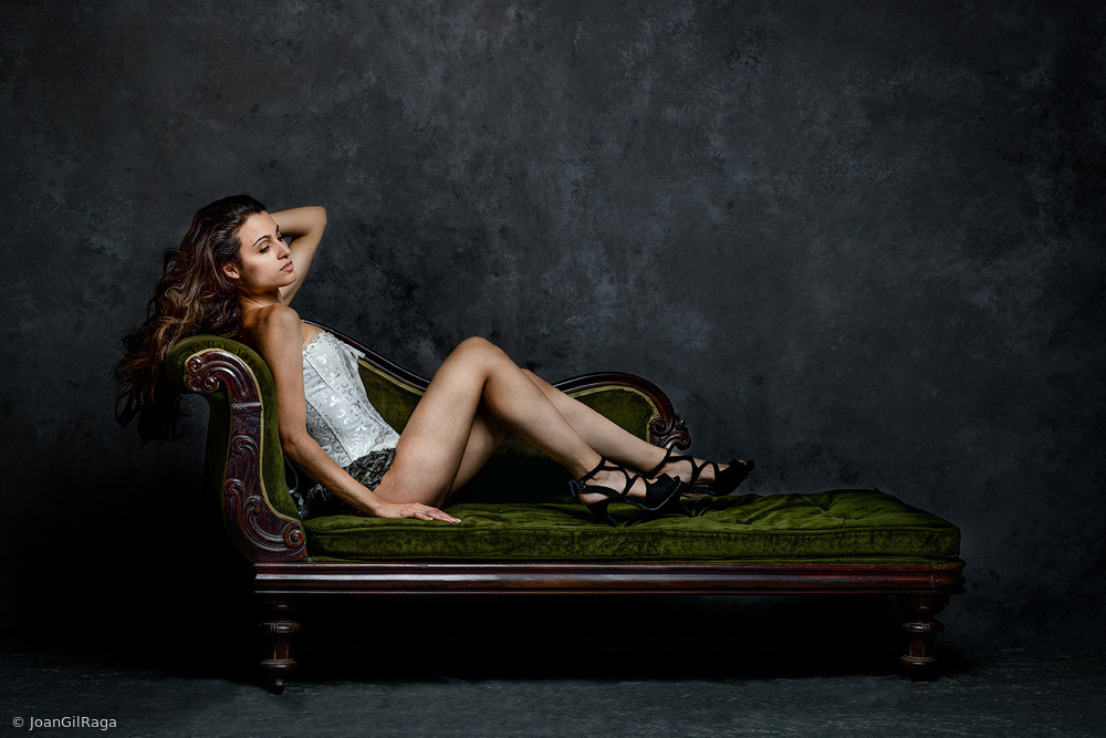 View this piece of fine art photography titled Bea on the couch by MIKHAIL POTAPOV