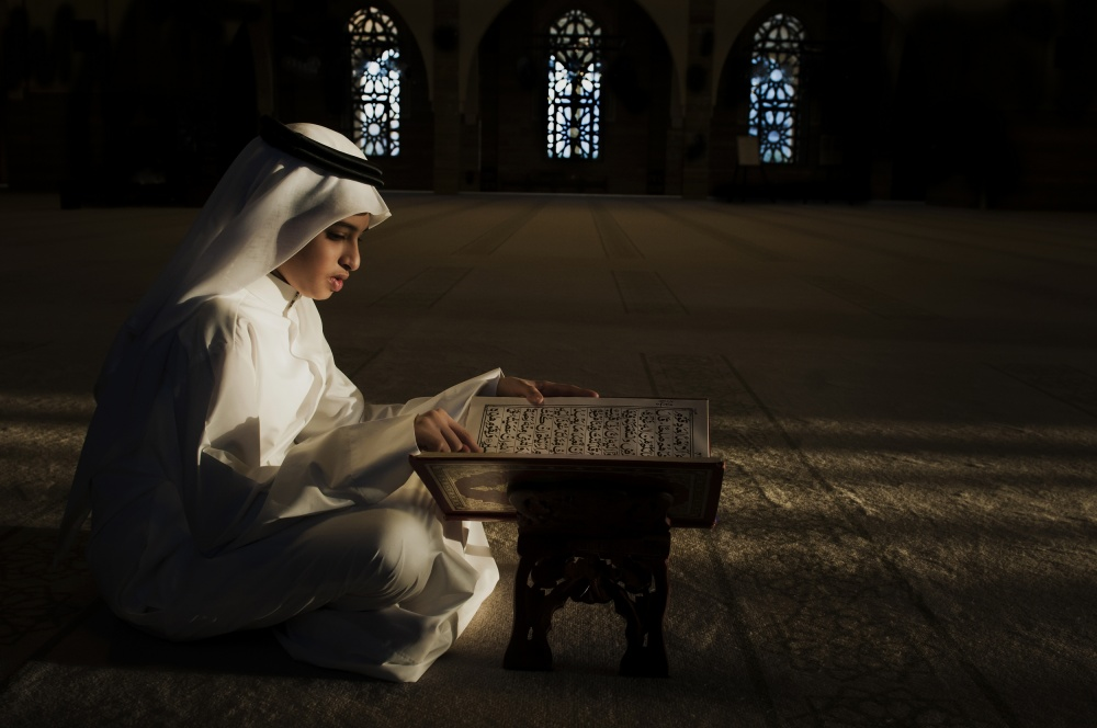 A piece of fine art art photography titled I Read the Qoran by Saeed Dhahi