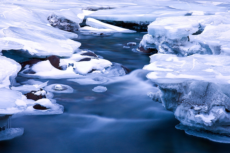 A piece of fine art art photography titled Flowing Water & Ice Formations by Doug Roane