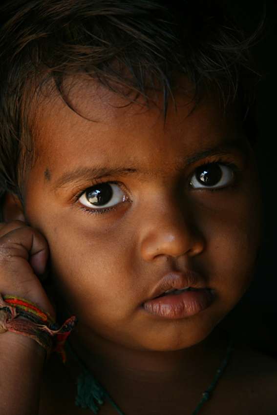 A piece of fine art art photography titled  Eyes of India by sasson haviv