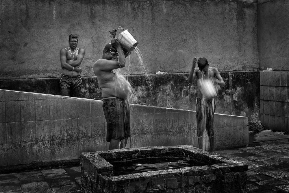 Washing in the Hot Wells. Kanniyai Sri Lanka.