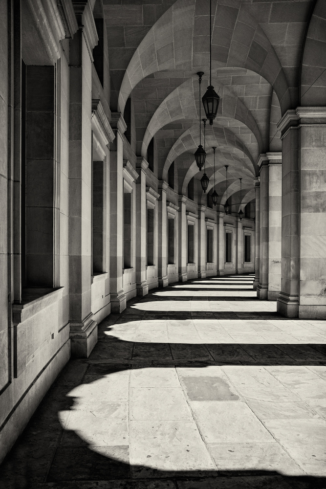 A piece of fine art art photography titled Curved Corridor by Louise Wolbers