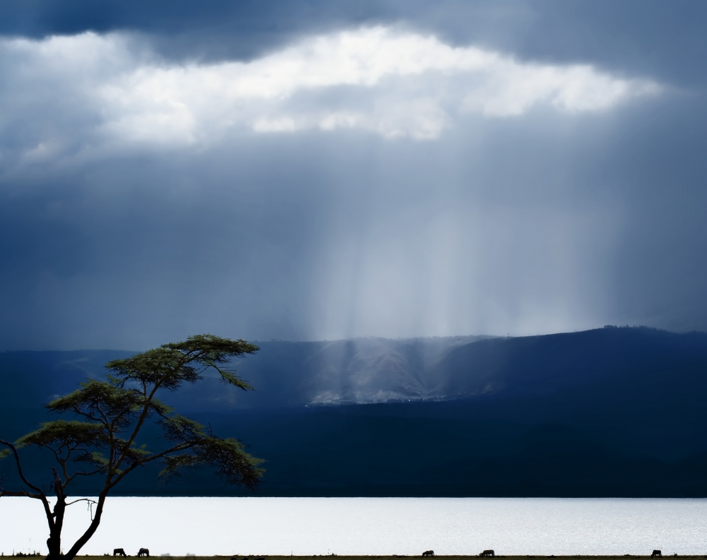 A piece of fine art art photography titled Clouds Over Lake Naivasha by Piet Flour