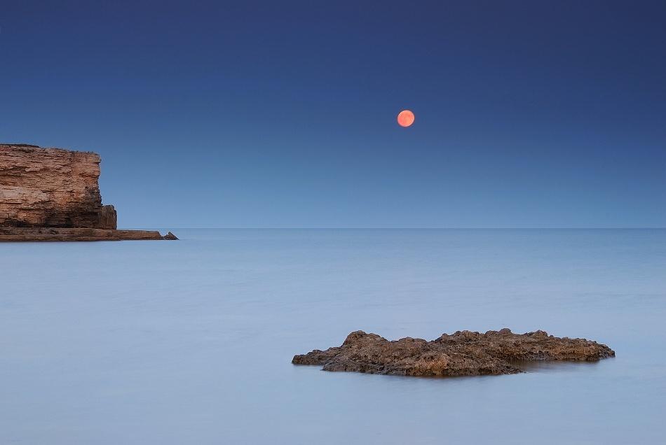 A piece of fine art art photography titled About Moon by Yelena Yemchuk