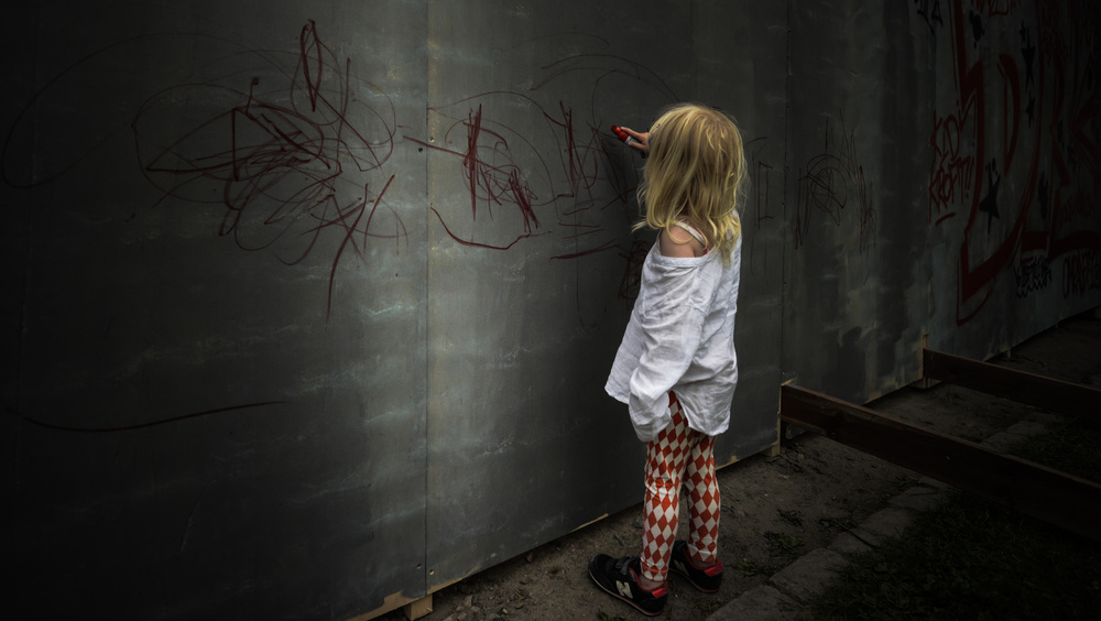 A piece of fine art art photography titled The Girl With the Red Pen by Jacques Montel