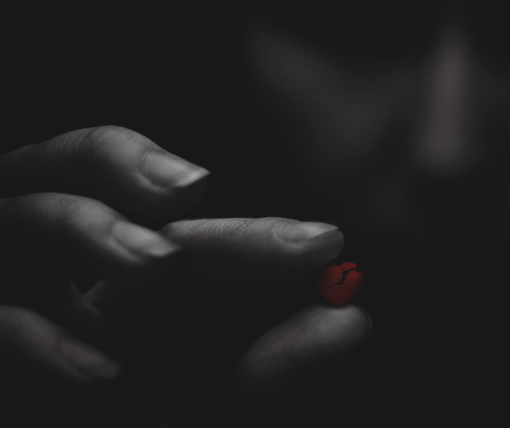 A piece of fine art art photography titled Broken Red Heart In the Moody Girl's Hands by Aleksandr Sumarokov