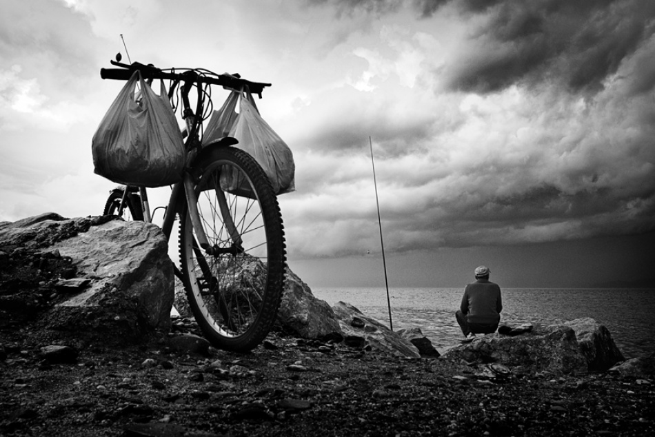 A piece of fine art art photography titled Fisherman and Bike by Enzo Penna