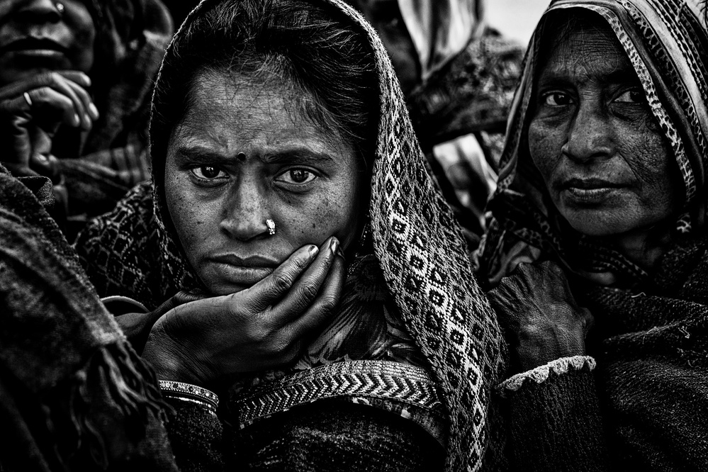A piece of fine art art photography titled Waiting for a Free Eye Check-up and Screening - Netra Kumbh - Prayagraj-India by Joxe Inazio Kuesta Garmendia