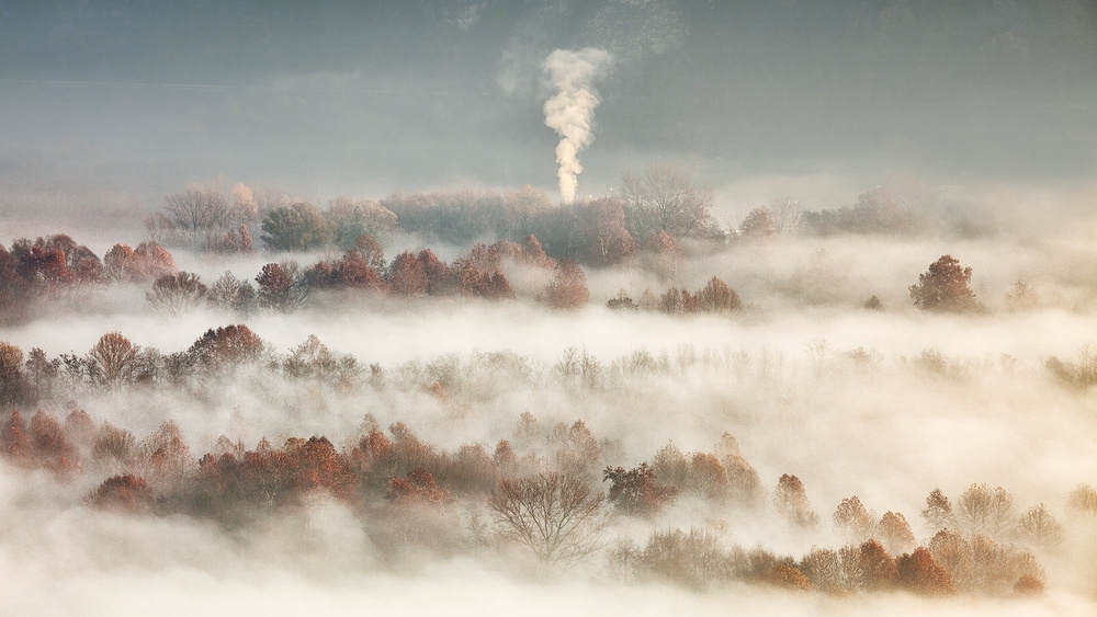 A piece of fine art art photography titled Smooking In the Misty Valley by Fiorenzo Carozzi