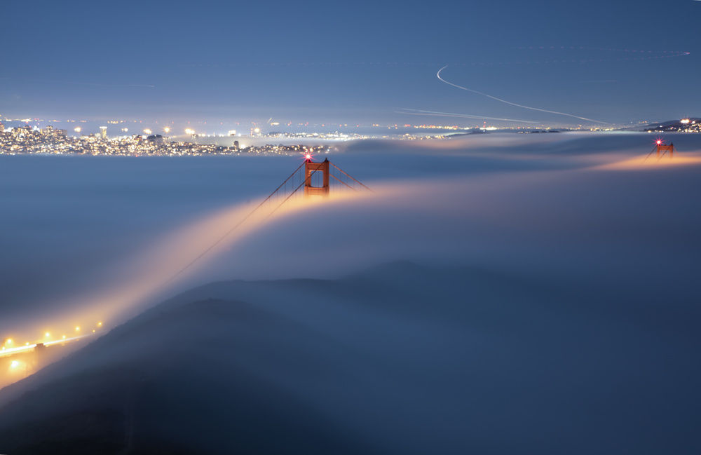 View this piece of fine art photography titled The magic Blanket over Golden Gate Bridge by Alessandro Traverso