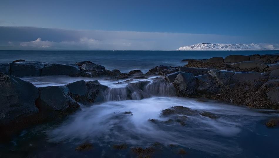 A piece of fine art art photography titled Ocean Waterfall by Raymond Hoffmann