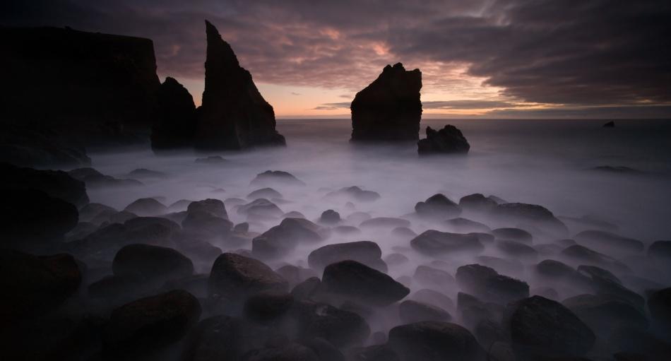 A piece of fine art art photography titled Black Beach by Raymond Hoffmann
