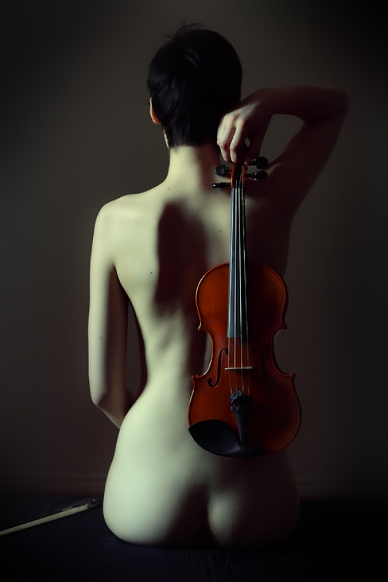 A piece of fine art art photography titled The Violin by Michel Feugeas