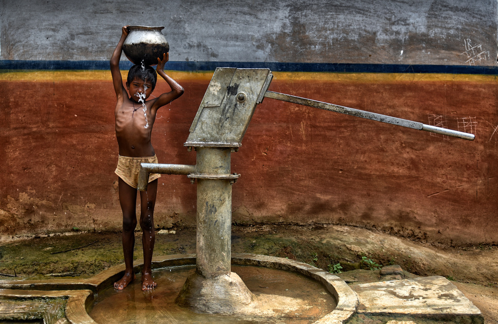 A piece of fine art art photography titled Struggle for Water by Avishek Das