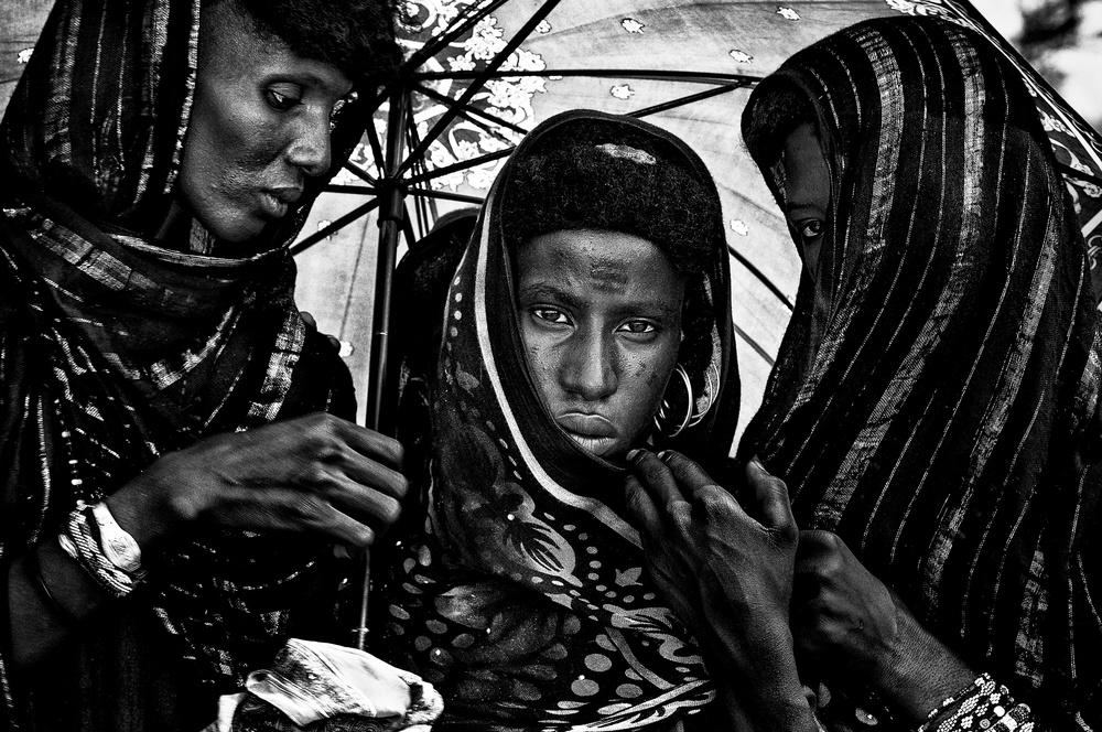 A piece of fine art art photography titled Peul Women at the Gereworl Festival - Niger by Joxe Inazio Kuesta Garmendia