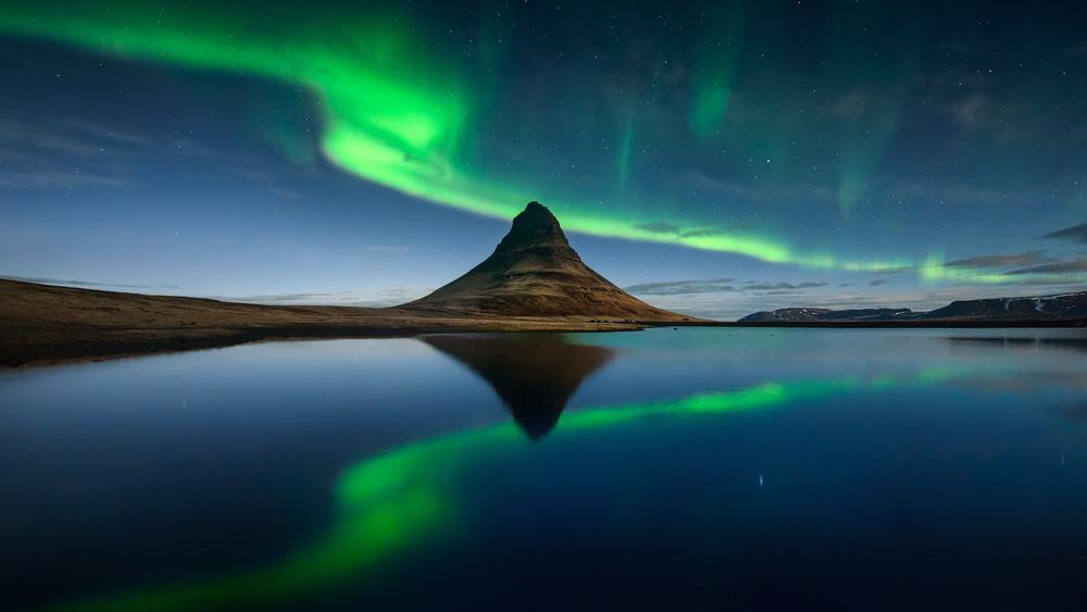 A piece of fine art art photography titled Kirkjufell Green Reflection by Jesús M. García