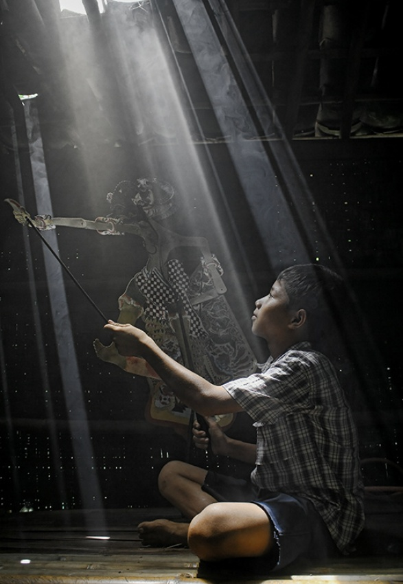A piece of fine art art photography titled Belajar Mendalang  (puppet Learning ) by nico fredia
