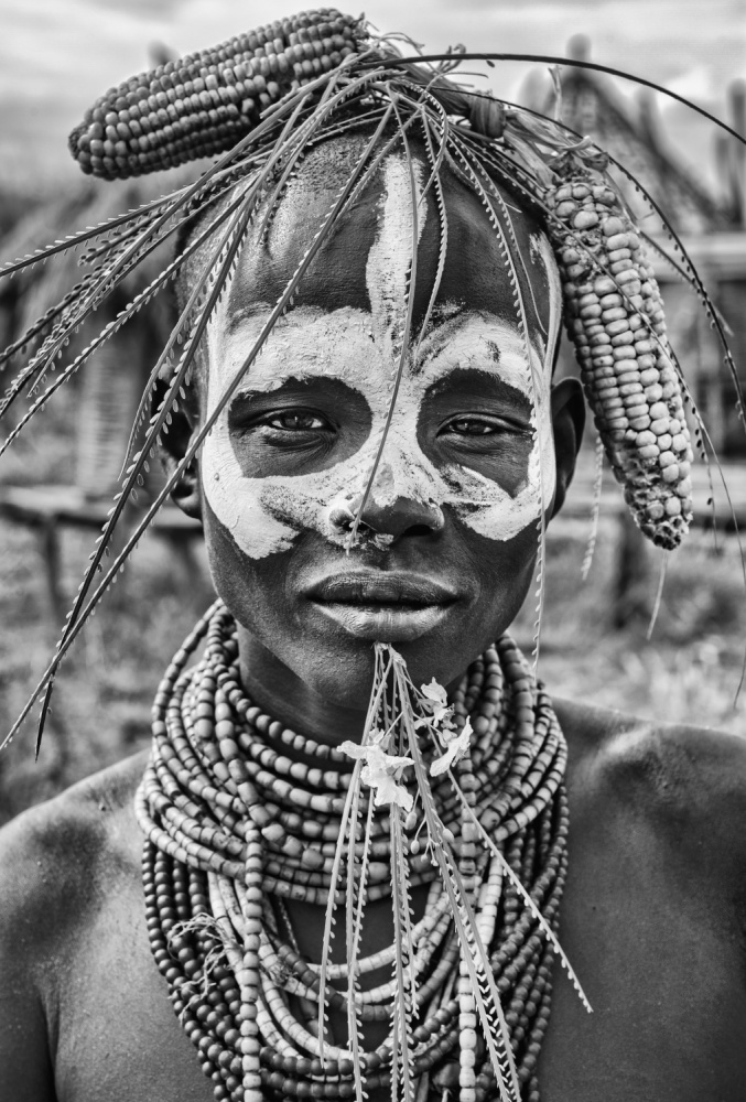 A piece of fine art art photography titled A Woman of the Karo Tribe (Omo Valley-Ethiopia) by Joxe Inazio Kuesta Garmendia