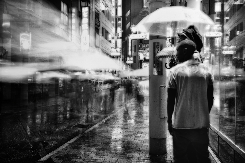 A piece of fine art art photography titled A Night In the Rain by Tatsuo Suzuki