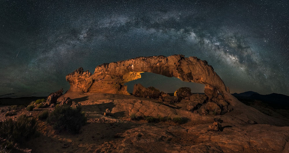 A piece of fine art art photography titled Milky Way Over the Sunset Arch by Hua Zhu