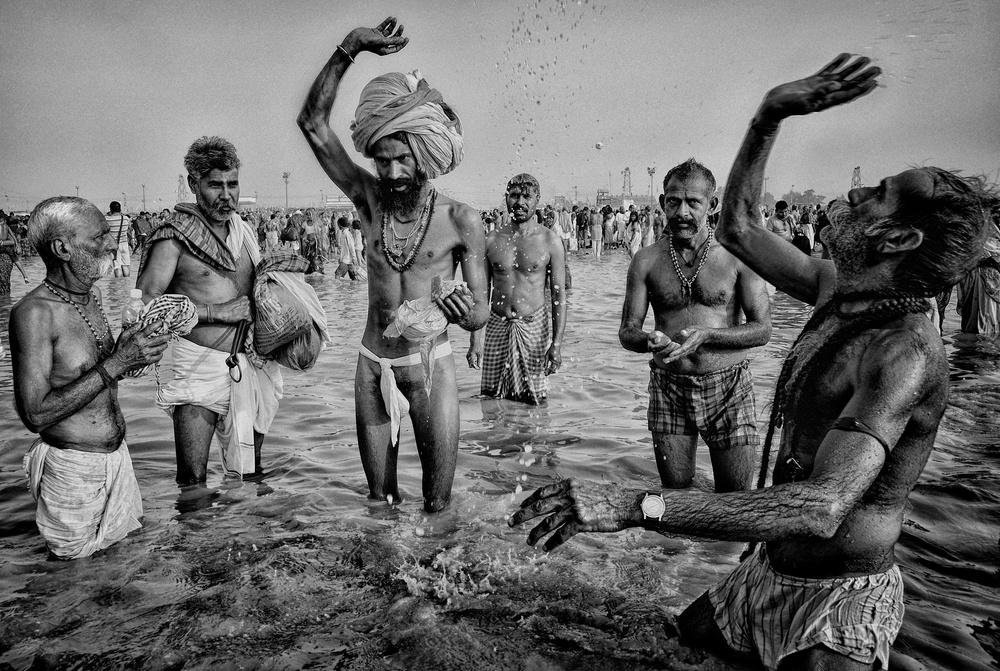 A piece of fine art art photography titled Holy Makar Bath at Gangasagar by Avishek Das