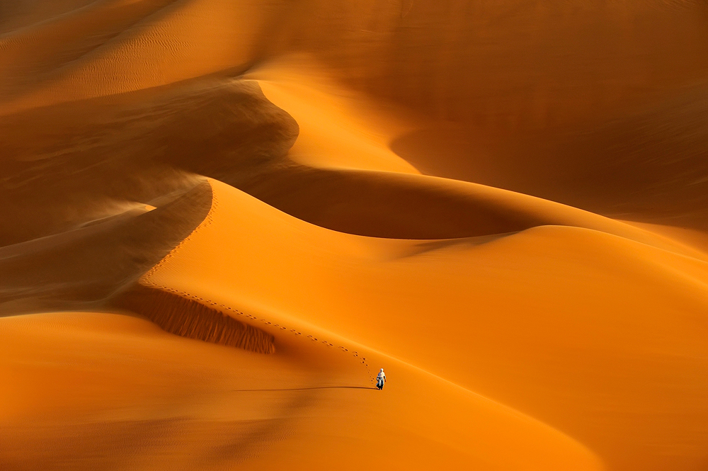 A piece of fine art art photography titled The Lone Touareg by Marsel van Oosten