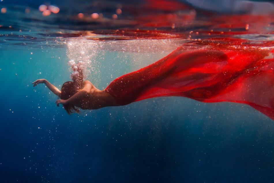 Underwater dance. Red tail.
