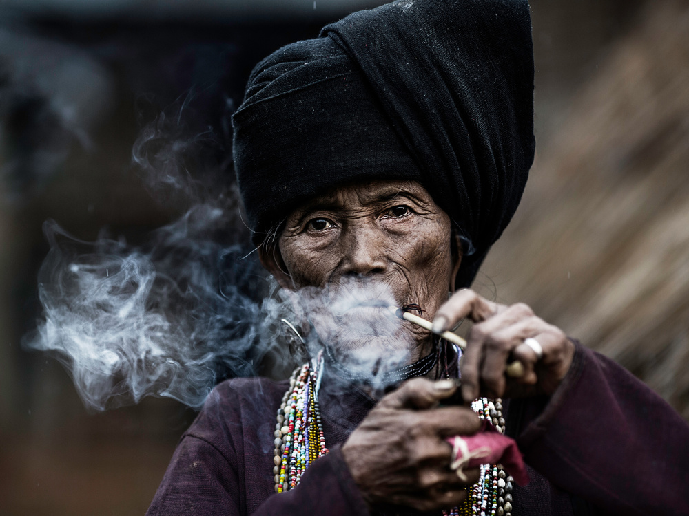 A piece of fine art art photography titled Smoking 2 by Amnon Eichelberg