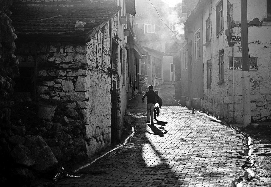 A piece of fine art art photography titled Run Boy Run by ozkanalgul