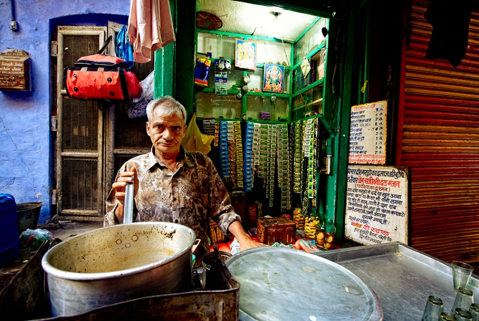 A piece of fine art art photography titled Chaiwallah ( Tea Seller ) by Prateek Dubey