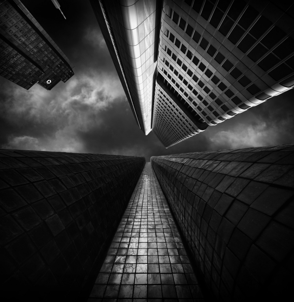 A piece of fine art art photography titled Silver Tower Meets Artwork In Front of It by Wolfgang Mothes