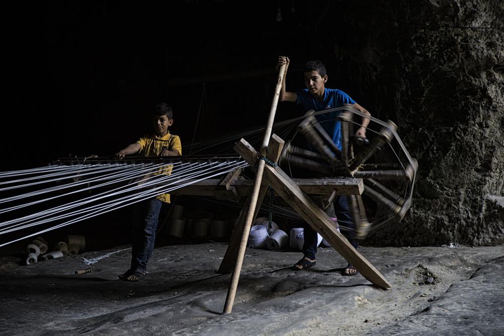 A piece of fine art art photography titled Hemp Cord Workers by Özden Sözen