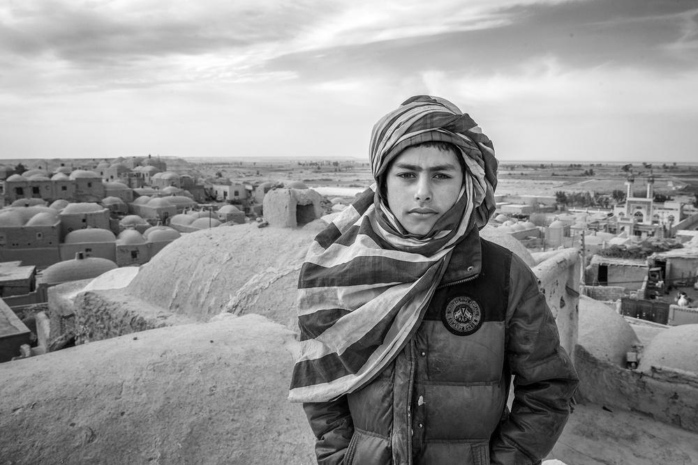 A piece of fine art art photography titled Sistani Boy by Amir Hossein Kamali | امیرحسین کمالی