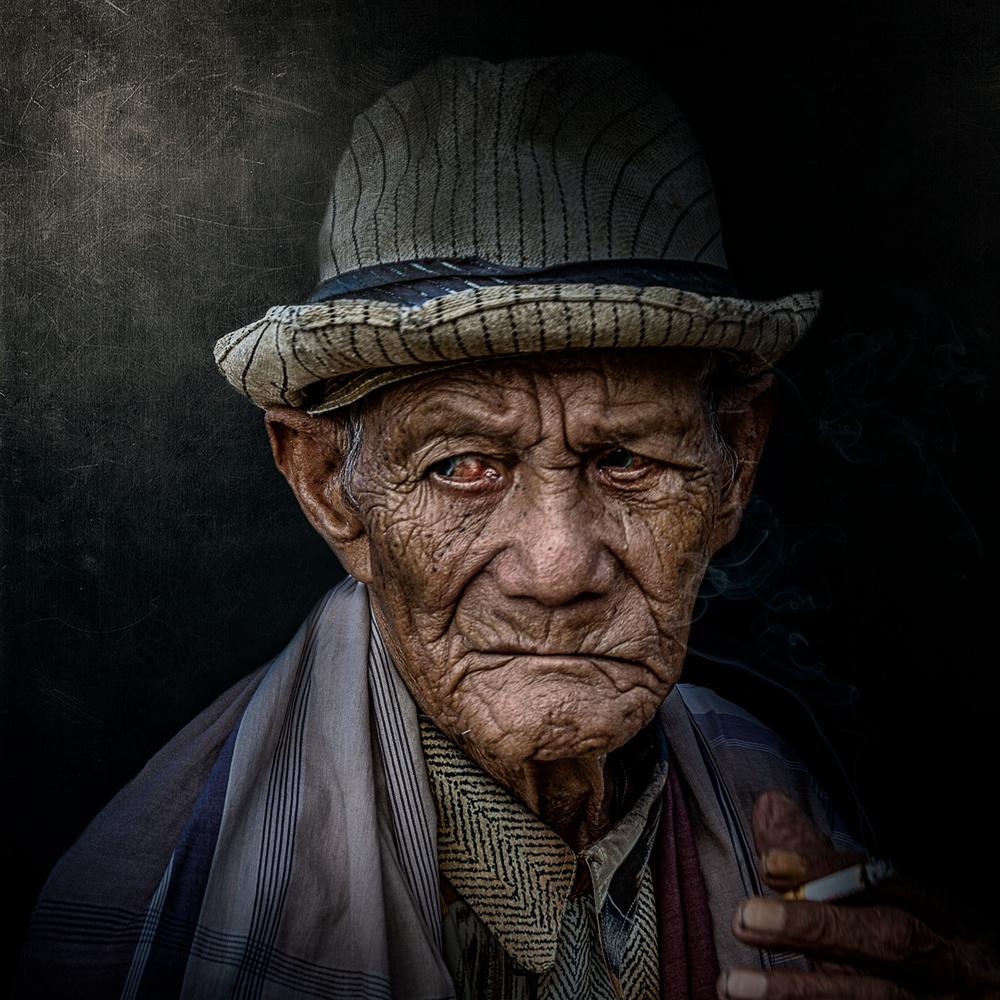 A piece of fine art art photography titled The Smoker by GianStefano Fontana Vaprio