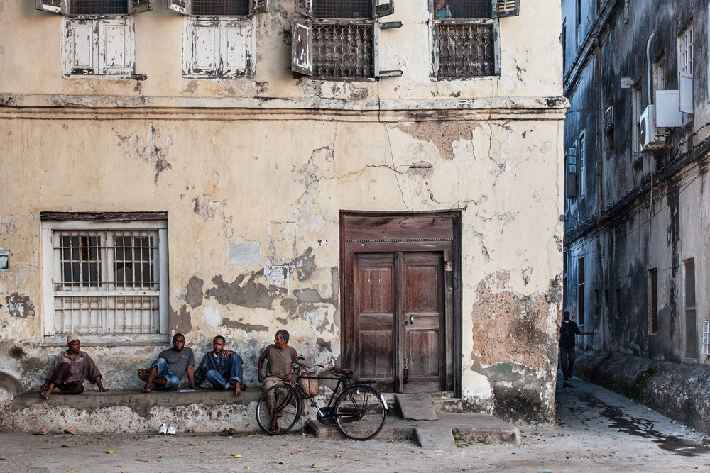 A piece of fine art art photography titled An Evening In Stone Town by Michel Guyot