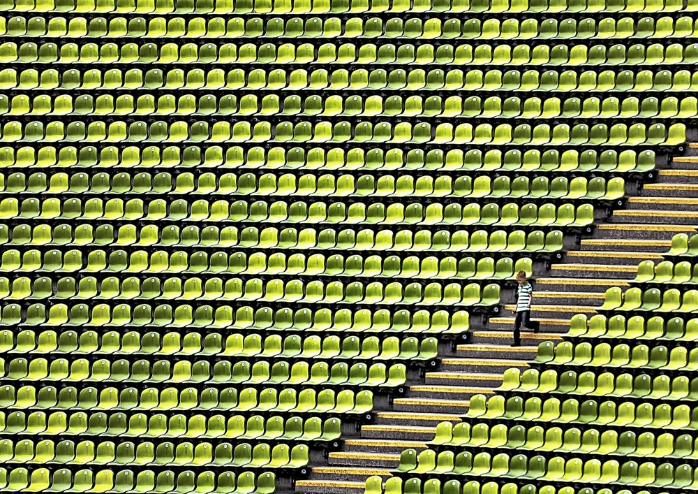 A piece of fine art art photography titled Small Boy - Plenty Stadium by Herbert A. Franke