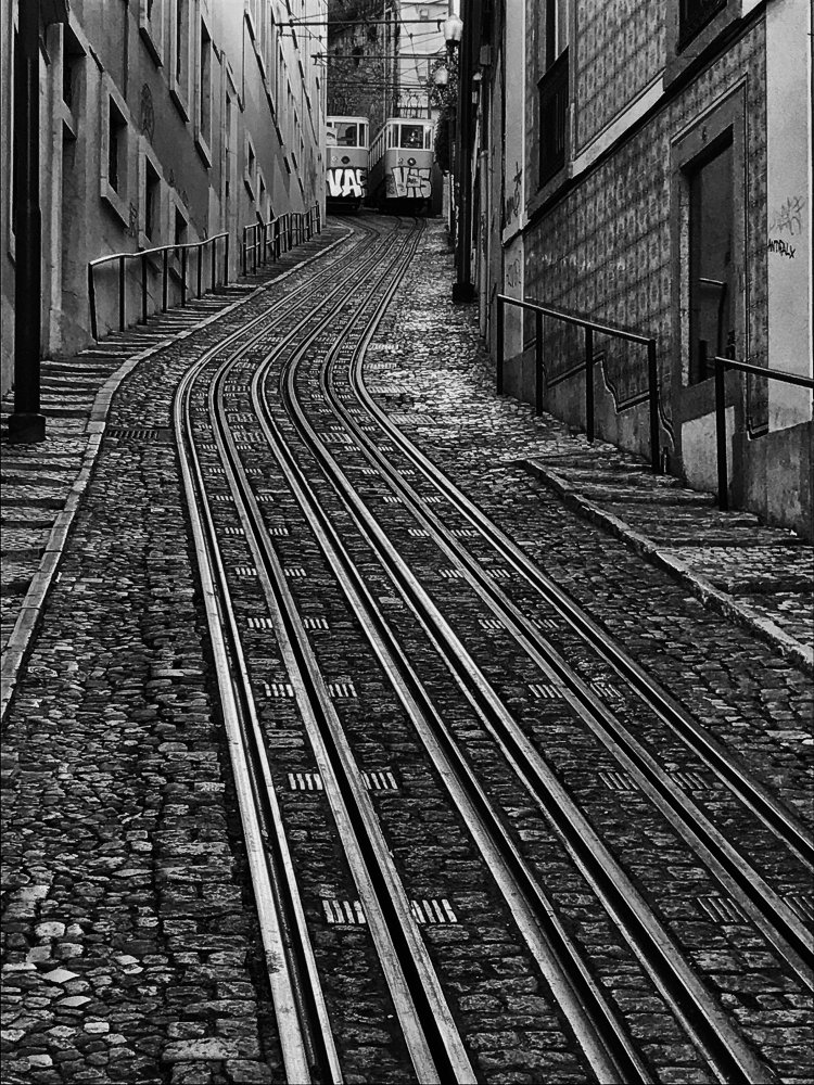 A piece of fine art art photography titled Trams In Lisbon by Jean-Louis VIRETTI