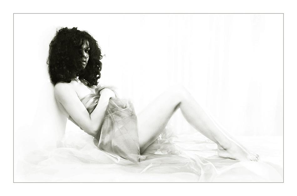 A piece of fine art art photography titled White Listening by Ileana Bosogea-Tudor
