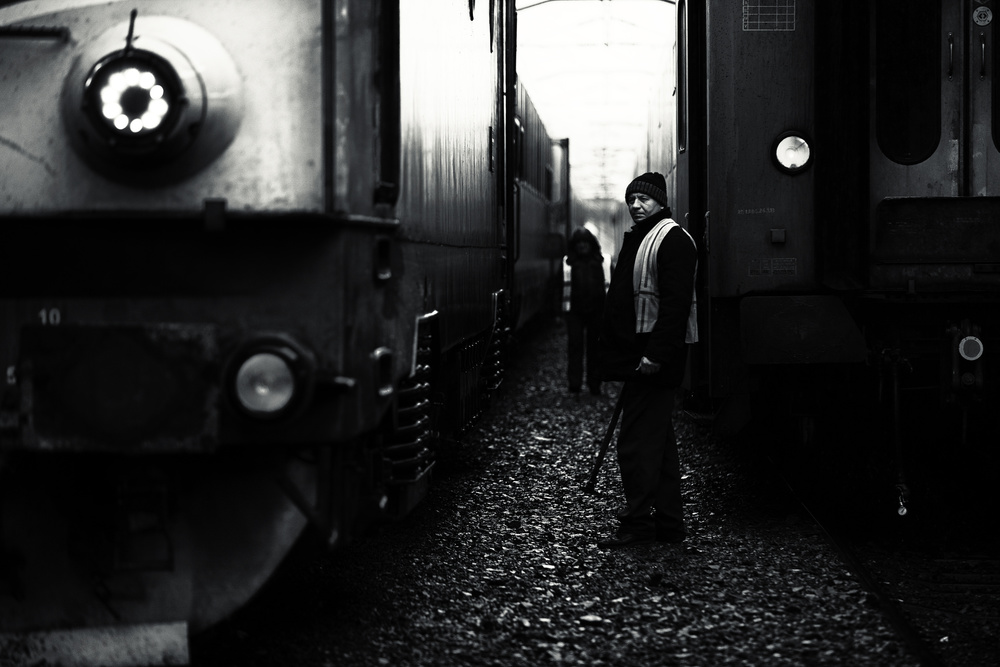 A piece of fine art art photography titled A Life Between Trains by Julien Oncete