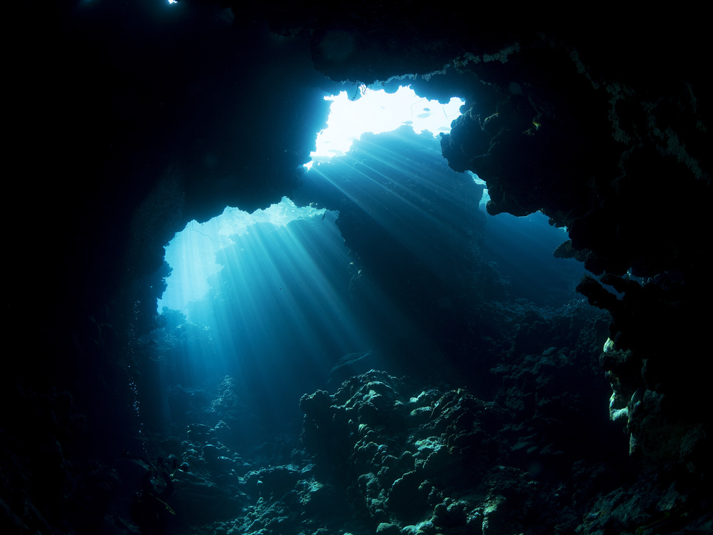 A piece of fine art art photography titled Underwater Cave by Ilan Ben Tov