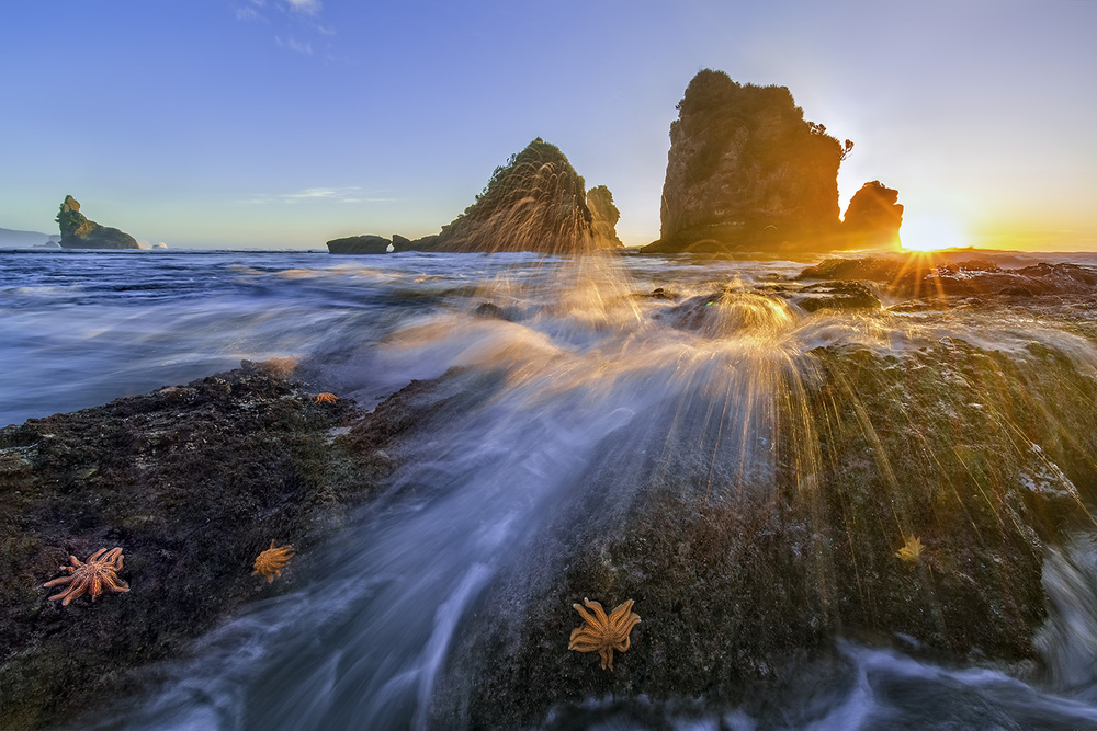 A piece of fine art art photography titled Starfish Rocks by Hua Zhu