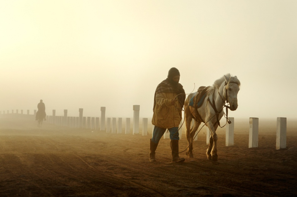 A piece of fine art art photography titled Horsemen On a Foggy Morning by Mitchell Kanashkevich