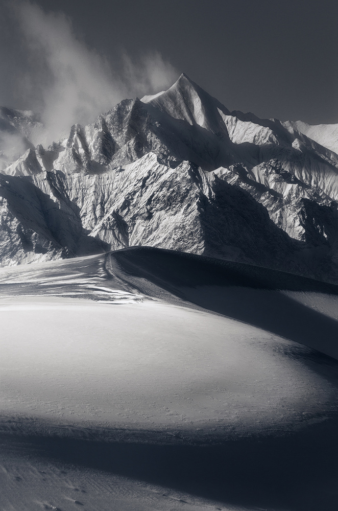 View this piece of fine art photography titled Snow mountain and sand dunes by Jose Manuel Martin