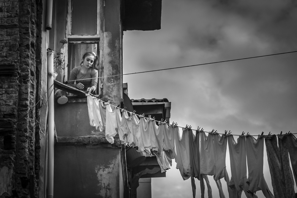 A piece of fine art art photography titled Laundry Day by Tunc Tuncel