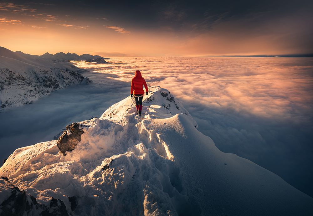 A piece of fine art art photography titled Above the Clouds by Karol Nienartowicz