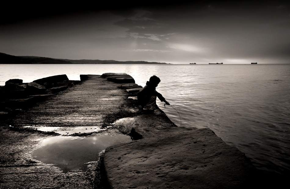 A piece of fine art art photography titled Little Fisherman by Giorgio Lorcet
