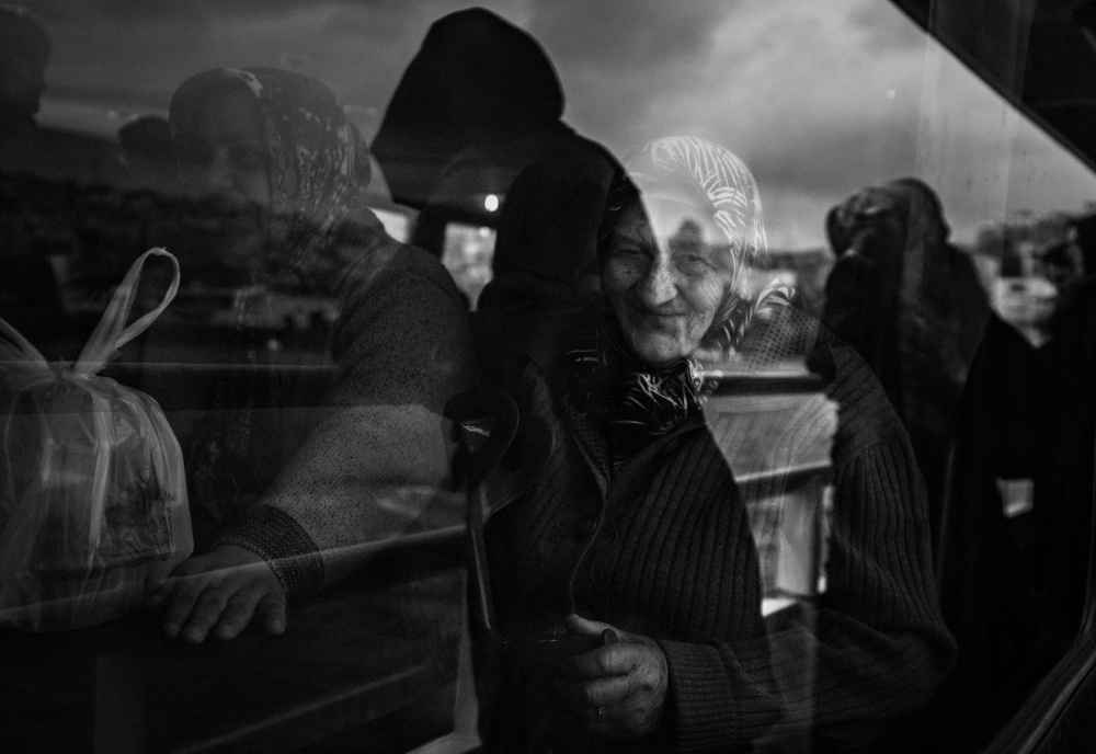 A piece of fine art art photography titled The Smiling Woman by Khalid N
